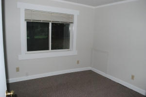 This is the first floor bedroom. It comes off the dining room. Not large but has two closets and ample room. And it has a marvelous view, especially first thing in the morning.