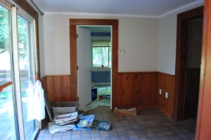 You're looking from the doorway into the first floor bedroom and the patio door is to the left (kitchen is to the right)