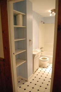More bathroom-- love the shelving in here. And yes, the toilet IS rather short and so is the sink. Weird.
