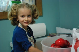 Jane washed apples for hours like a champ.